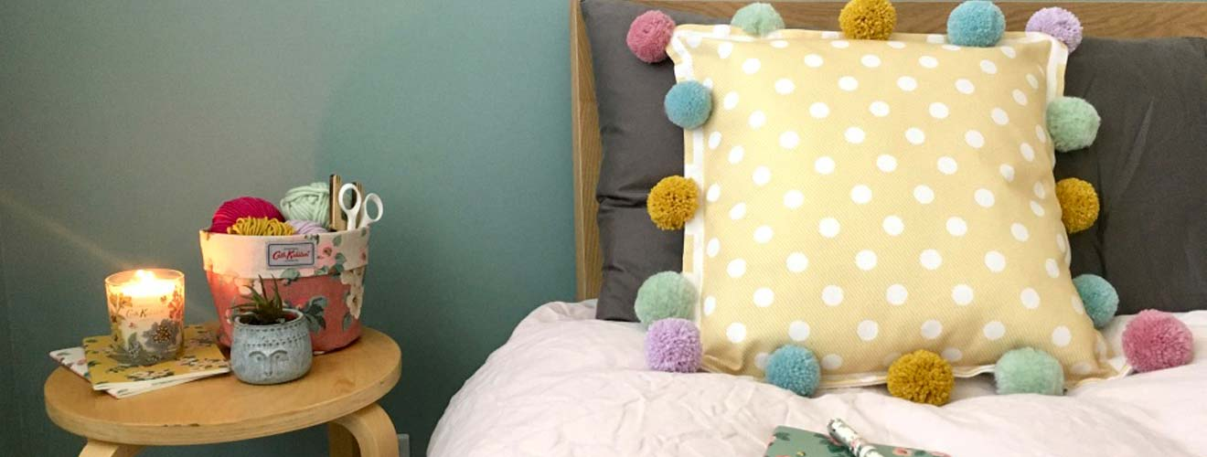 Upcycle a cushion with pom poms - Cath Kidston