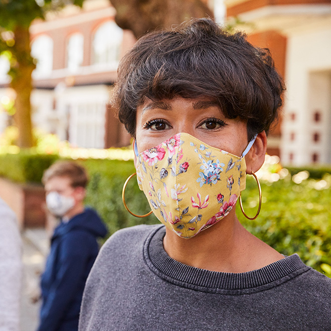 Woman in floral face covering - Cath Kidston